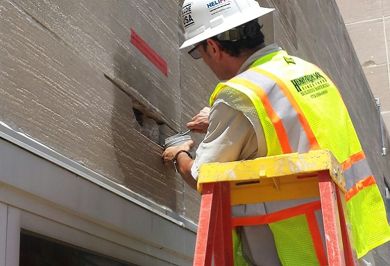 Contractor Applying Mortar to Surface